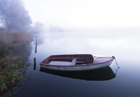Morning Mist on the Lake and a lonely boat, Germany, Bavaria, Wesslinger See - MBOF000029