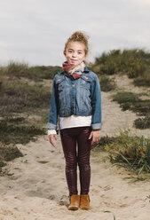 Spain, Galicia, Ferrol, smiling girl in beach dune - RAEF000014