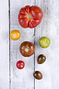 Different tomatoes on white wood - ODF001125