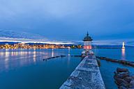 Switzerland, Geneva, Lake Geneva with harbor mole in the evening - WDF002836