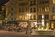 Switzerland, Geneva, cafes and restaurants at Place du Bourg-de-Four at night - WD002845
