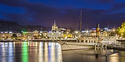 Switzerland, Geneva, Lake Geneva, cityscape with paddlesteamer at night - WD002861