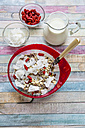 Cereal with chia seeds, coconut chips, wolfberries and milk on wood - SARF001278