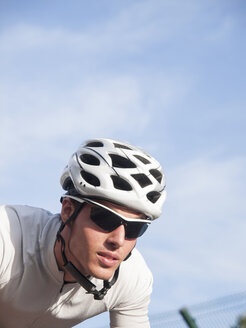 Portrait of racing cyclist with cycling helmet - RAEF000016