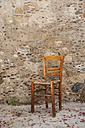Greece, Monemvasia, chair in old town - WWF003492
