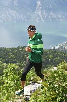 Italy, Trentino, young man jogging at Lake Garda - MRF001520