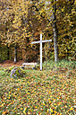 Austrian Innviertel, Wayside cross and empty bench at forest edge - WWF003429