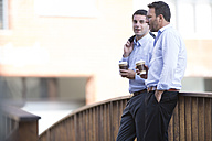 Business people taking a break, drinking coffee - ZEF003869