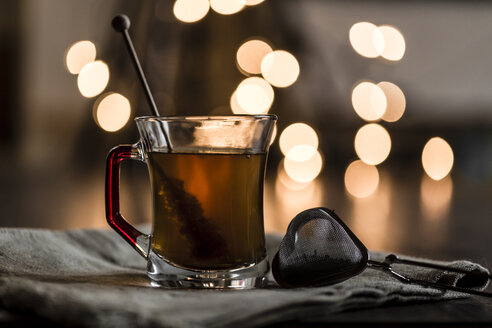 Glass of black tea, rock candy and heart-shaped tea strainer - SARF001287
