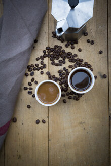 Two cups of coffee, cloth, espresso can and coffee beans - LVF002682