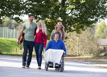 Young man in wheelchair with friends - WWF003643