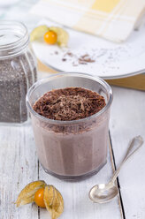 Glass of chocolate pudding with chia seeds sprinkled with chocolate shaving - ODF001083