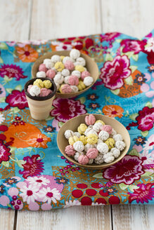 Two bowls of sugared chickpeas on cloth - MYF000864
