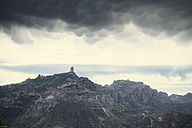 Spain, Canary Islands, Gran Canaria, clouds hanging over the mountains and Roque Nublo, as seen from Cruz de Tejeda - MFF001426