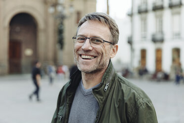 Spain, Canary Islands, Gran Canaria, Las Palmas, portrait of laughing mature man in front of Catedral de Santa Ana - MFF001439
