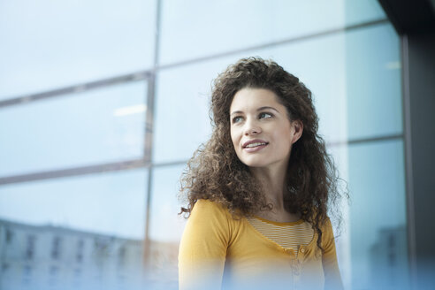 Smiling young woman at the window - RBF002336