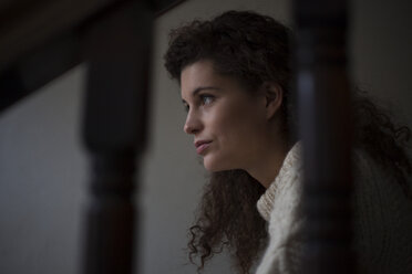Sad young woman on staircase - RBF002259