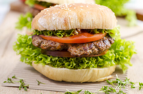 Homemade hamburger with minced beef and lettuce on sesame roll - OD001099
