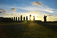 Chile, Easter Island, row of moais at Ahu Tongariki at sunset, Tourist photographing - GEMF000201