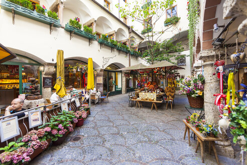 Austria, Salzburg, arcades with pavement cafe at historic old town - AM003715