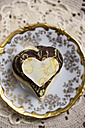 Stack of homemade chocolate hearts on plate - MYF000876