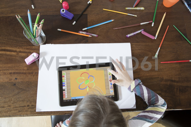 Little girl using digital tablet for drawing - SARF001314