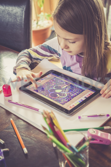 Little girl using digital tablet for drawing - SARF001305