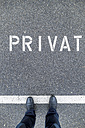 Man standing on private parking area - EJWF000671