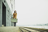 Young woman with suitcase on platform - UUF003261