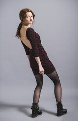 Young woman in backless dress - UUF003292