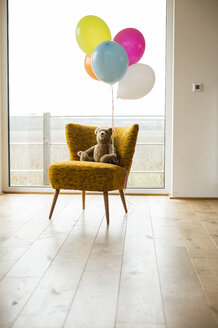 Bunch of balloons, teddy bear and chair by the window - UUF003305