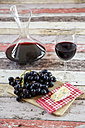 Blue grapes, cheese, decanter and glass of red wine - SARF001326
