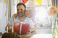 Son surprising his father with birthday present - PDF000698