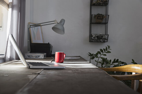 Desk with laptop and coffee cup at home office - PDF000761