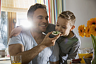 Father and son having breakfast together - PDF000753