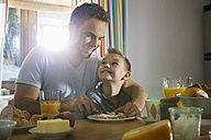 Father and son having breakfast together - PDF000730