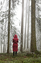 Austria, woman standing alone in the wood - WWF003786