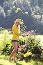Austria, teenage girl gardening - WWF003818