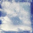 Water drops on wondow pane against cloudy sky - LVF002753