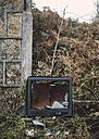 Spain, Galicia, Ferrol, broken Tv in a ruinous place - RAE000035