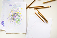Child's drawing and colored pencils on a table - LVF002773