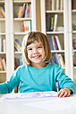Portrait of smiling little girl with drawing - LVF002765