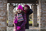 Two smiling little girls in a park on a winter day - MGOF000055