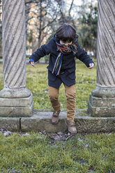 Little boy having fun in a park on a winter day - MGOF000062