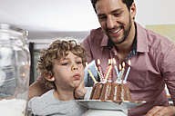 Father and son with birthday cake - RBF002426