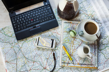 Planning a journey with maps, cell phone and coffee - SBDF001621