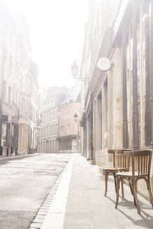 Luxembourg, Luxembourg City, empty street with two chairs on the pavement - CHPF000038