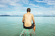 Philippines, Palawan, El Nido, man sitting on the bow of a boat - GEMF000035