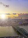 Germany, Cologne, city view with Cologne Cathedral, Rhine River and Hohenzollern Bridge in the foreground - MAD000134