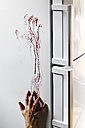 Blood-stained hand on refrigerator - MID000058